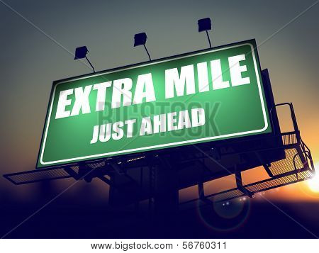 Extra Mile Just Ahead - Green Billboard on the Rising Sun Background. poster
