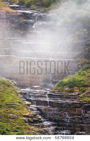 Small Cascading Stream On A Foggy Mountain