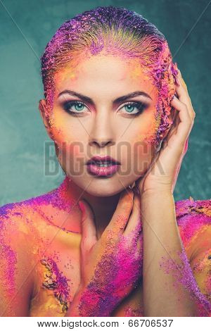 Beautiful young woman with conceptual colourful body art