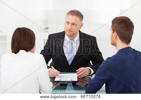 Couple Consulting Financial Advisor