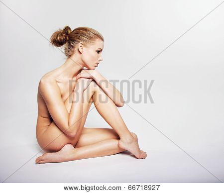 Gorgeous Young Nude Woman Sitting On The Floor