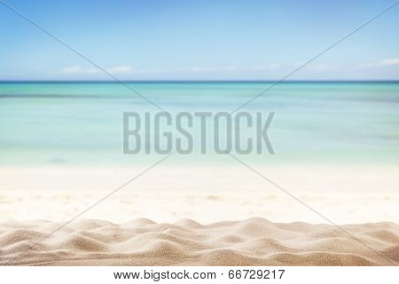Sandy summer beach with blur sea on background