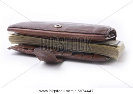 tightly- stuffed  purse with dollar banknotes on white background poster