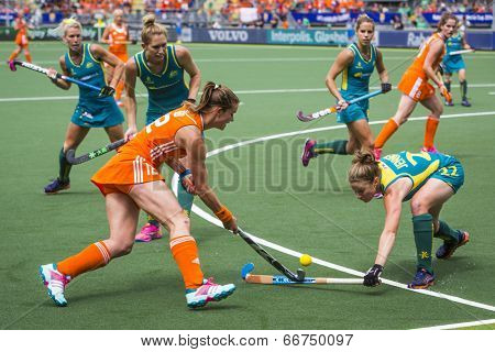 THE HAGUE, NETHERLANDS - JUNE 14 2014: Lidewij Welten tries to rush through the Australian Defence into the cirlcle during the final match at the world championships Hockey