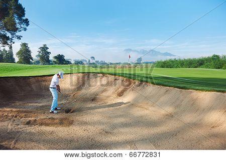 golf shot from sand bunker golfer hitting ball from hazard