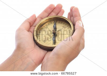 Hands holding antique directional compass