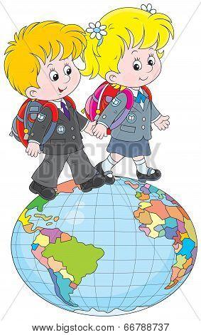 Schoolchildren going on a globe