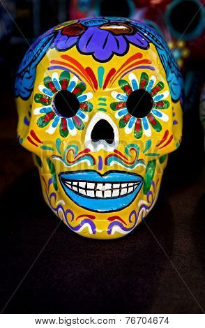 An abstract stylized skull is displayed for Dia De los Muertos. poster
