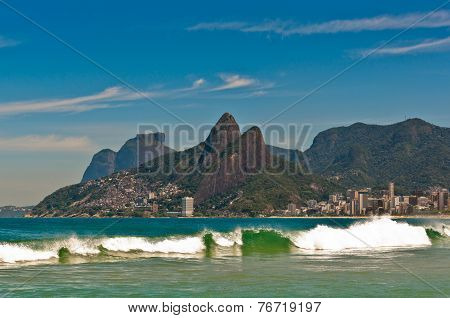 Waves in Ocean at Ipanema Beach with Mountain Landscape