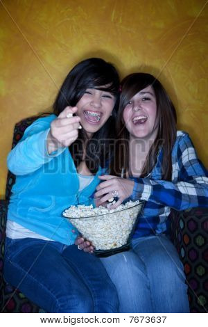 Pretty Hispanic Girls With Popcorn Watching Television