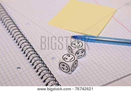 Open Exercise Book With Mood Dice And Yellow Sticky Card