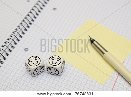 Open Exercise Book With Mood Dice (happy) And Yellow Sticky Card