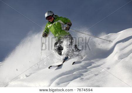 Female skier with powder snow