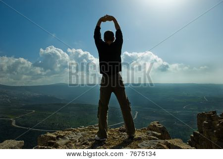 man standing at the precipice