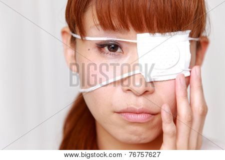woman with the eyepatch