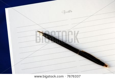 A wedding guest book isolated on blue