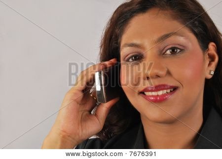 indian business woman on mobile phone