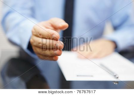 Businessman Offering A Handshake And Contract