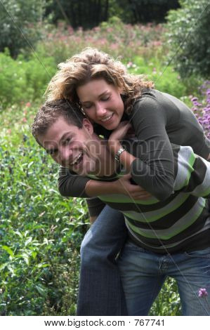 Piggyback ride in the garden