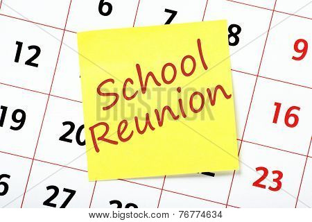 Reminder of a School Reunion written on a yellow sticky note and attached to a wall calendar poster