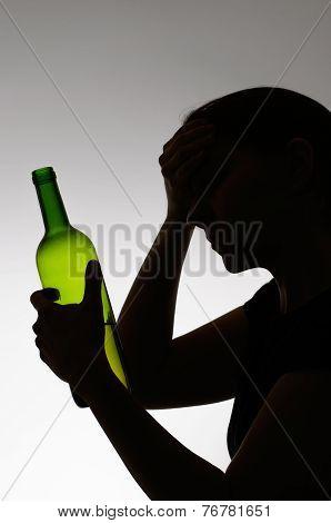 Silhouette Of A Sad Drinker