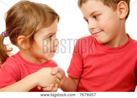 Brother and sister in pink shirts with smile shake hands