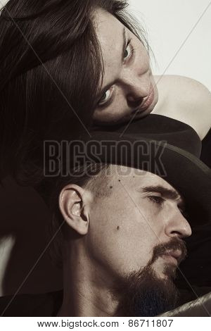 Man Wearing  Hat And A Young Woman