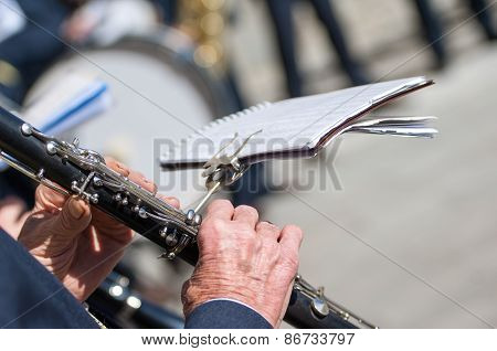 Man Plays The Clarinet During A Religious Cerimony