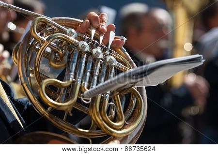 Man Plays The Horn During A Religious Cerimony