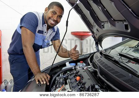 Confident Auto Mechanic Smiling And Giving Thumbs Up