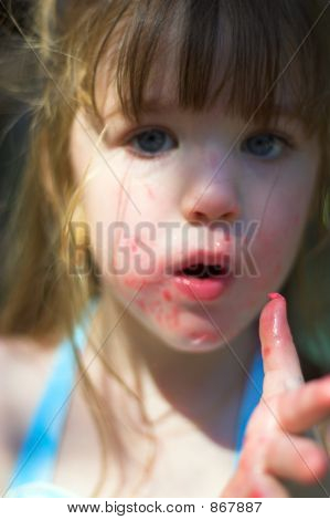 Young Girl With Sticky Cotton Candy Fingers