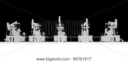 Gray silhuettes of oil pump-jacks. Front view