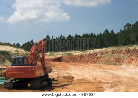 Strata Of Rock And Dirt With Heavy Equipment