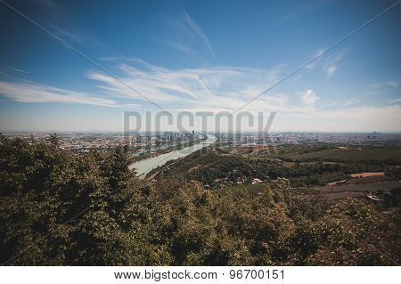 view of vienna skyline with danube river Austria poster