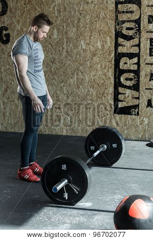 Man Preparing To Weightlifting
