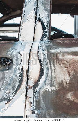 Rusted torched car detail