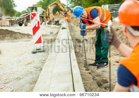 Tired Road Construction Worker