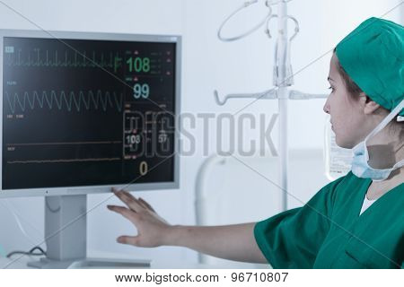 Surgeon Looking At Medical Monitor