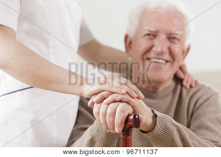 Senior Man And Helpful Nurse
