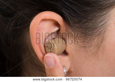 Woman Ear With Hearing Aid