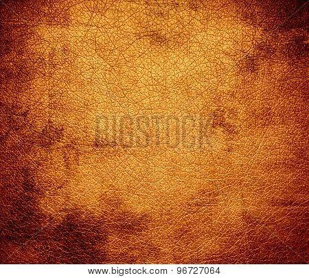 Grunge background of deep saffron leather texture