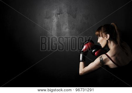 Boxer Woman with Red Gloves on Black Background