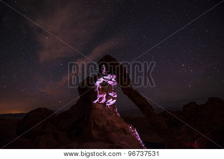 Elephant Rock At Night Lit By A Flashlight Against Bright Starry Sky