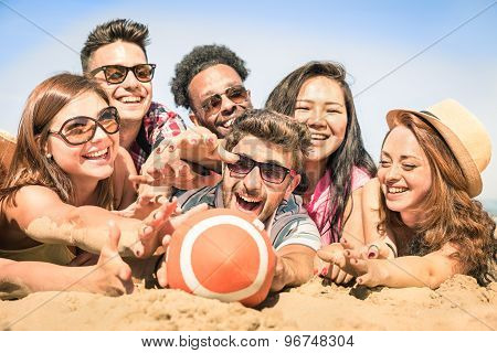 Group Of Multiracial Happy Friends Having Fun At Beach Games - International Concept Of Summer Joy