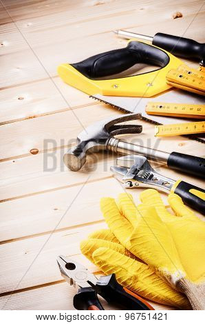 Set Of Various Tools On Wooden Background