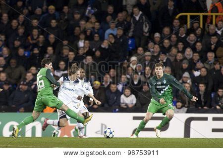 LONDON ENGLAND, November 11 2010: Werder Bremen's forward Onur Ayik fouls Tottenham's midfielder Luka Modric during the UEFA Champions League match between Tottenham Hotspur FC and Werder Bremen