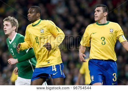 LONDON, ENGLAND. March 02 2010: Ireland's Kevin Doyle, Brazil's Juan (4) and Lucio (3) during the international football friendly between Brazil and the Republic of Ireland