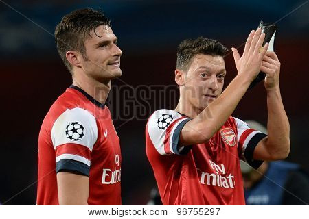 LONDON, ENGLAND - Oct 01 2013: Arsenal's forward Olivier Giroud from France and Arsenal's midfielder Mesut Ozil from Germany during the UEFA Champions League match between Arsenal and Napoli.