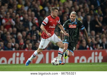 LONDON, ENGLAND - Oct 01 2013: Arsenal's midfielder Aaron Ramsey from Wales and Napoli's midfielder Valon Behrami from Switzerland during the UEFA Champions League match between Arsenal and Napoli.