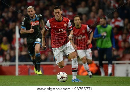 LONDON, ENGLAND - Oct 01 2013: Arsenal's midfielder Mesut Ozil from Germany runs with the ball during the UEFA Champions League match between Arsenal and Napoli.